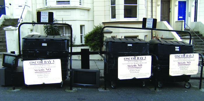 Televisions dumped by communal bins in Carisbrooke Road, in spite of the strict notice, (inset).