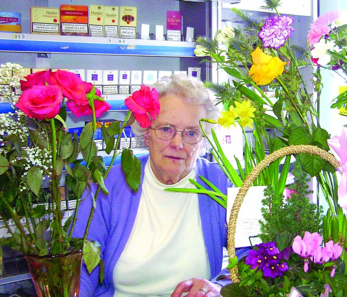 Birthday girl- picture shows Dorothy behind her counter as usual but surrounded by 80th birthday flowers.