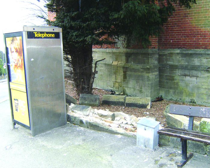 Damage to St Peters Church boundary wall by the telephone box in Chapel Park Road.