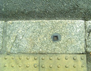 Kerbstone with metal pole socket