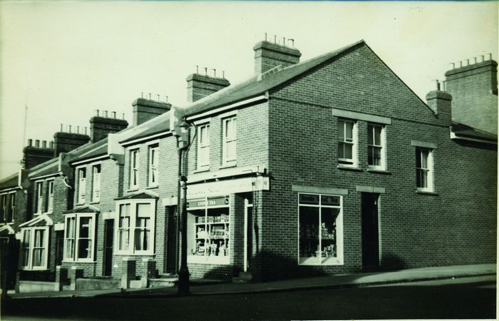 Shop on corner of Clarence Road and Aldborough Road. The original caption states 12, 14, 16 Clarence Road and 1, Aldborough Road. 1948. War damage re