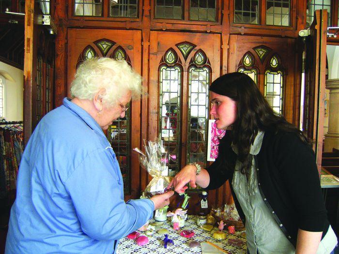 Shirley (right) talking to potential customer Stella Logan