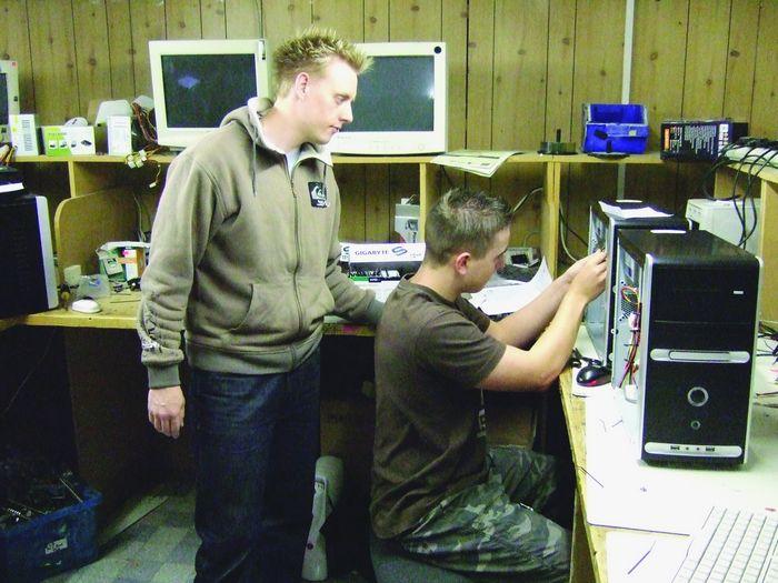 Tutor and work experience school lad in KC repair shop.