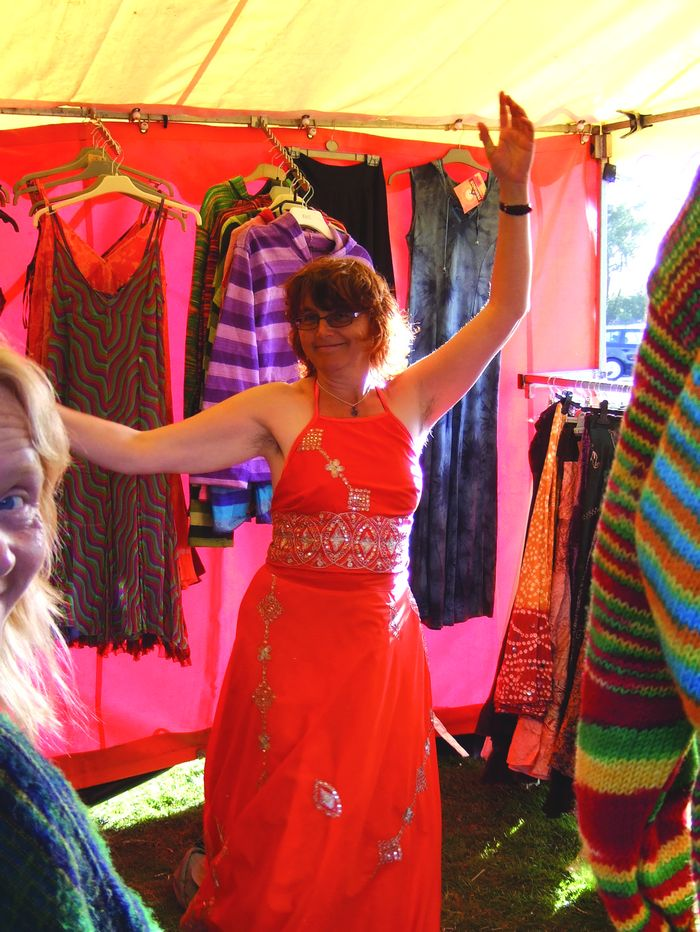 Dancing woman in clothes tent