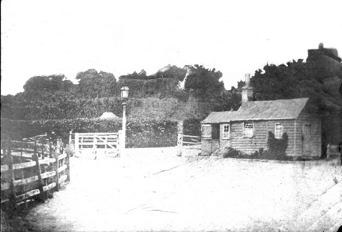 Tower Road Tollgate. Right, is the toll-keepers cottage, where the Tower Hotel now stands.
