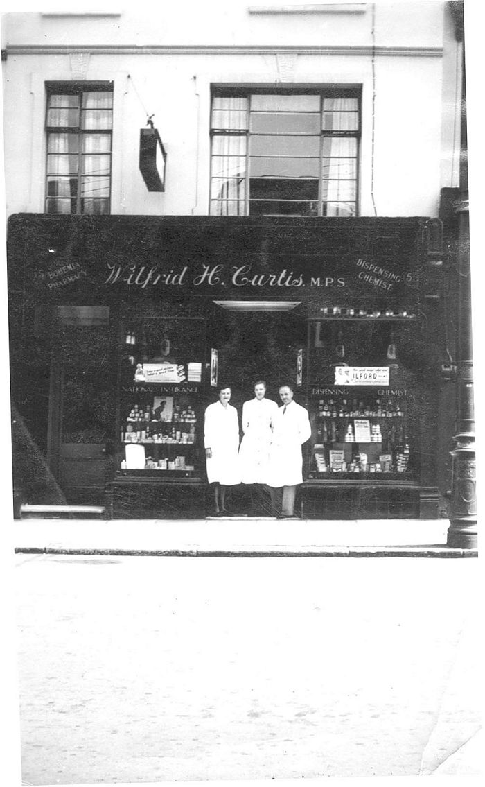 Chemists Wilfred H Curtis where Blooms Pharmacy now is. Photo approx 1945-50. Shown L-R, Miss Elphick, Mrs Vera Chalcraft & Mr Wilfred Curtis.