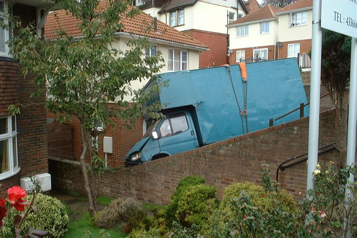 Drama in Chapel Park Road - a van plunges through a brick wall into the front garden of No. 58.