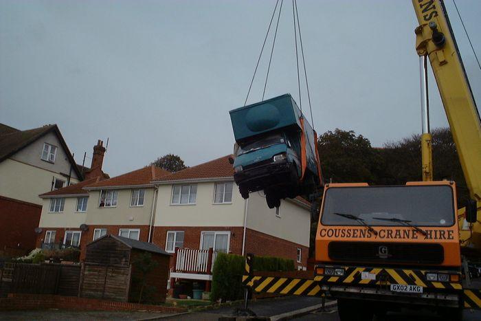 Chapel Park Road drama - runaway van being hoisted away from garden.