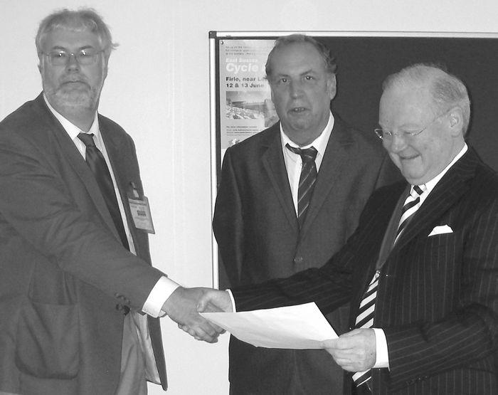 Cllr Cartwright (L) & Trevor Webb present petition to Bob Lacey of ESCC