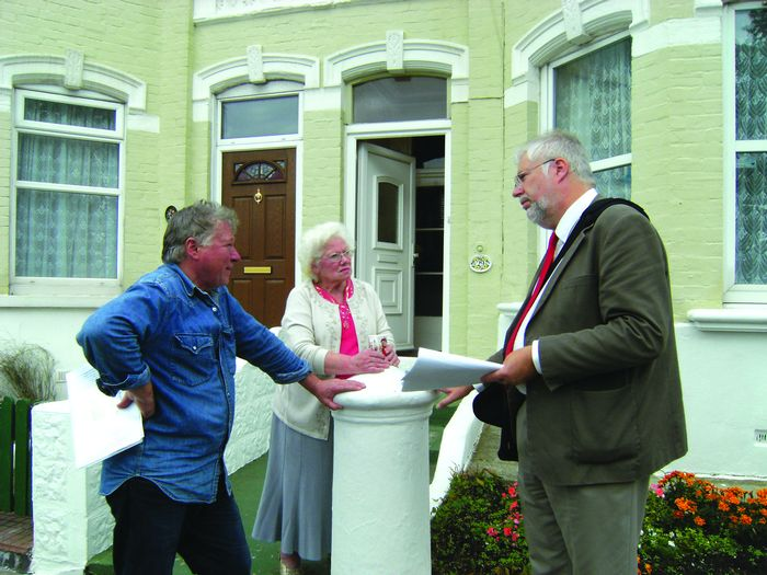 Bill Third and Lydia Adams of St Peters Road in discussion with councillor Andrew Cartwritght  SEE FULL STORY