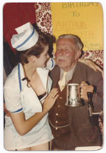 Arthur Booth's 76th birthday celebration in 1985, with a 'nurse' to see he doesn't go over the limit.