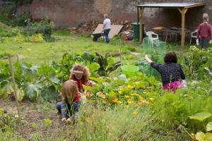 Walled Garden member Daniella and her children in a vegetable patch
